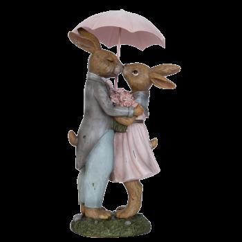 Kaninchen-Paar unter Regenschirm